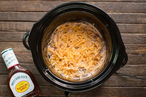 uncooked barbecue chicken dip in a slow cooker.