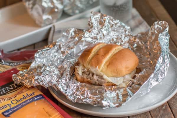 cheesy pork sandwich on foil