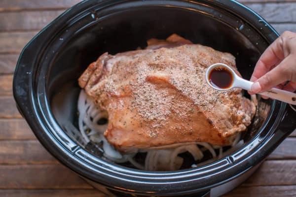 brown pork roast in slow cooker. Spoon with liquid smoke over it.