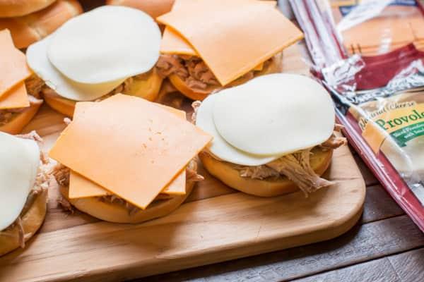 cheese slices on pork sandwiches.