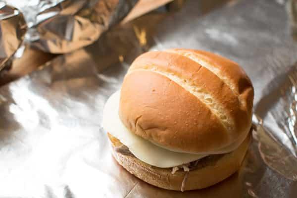 pork sandwich on foil