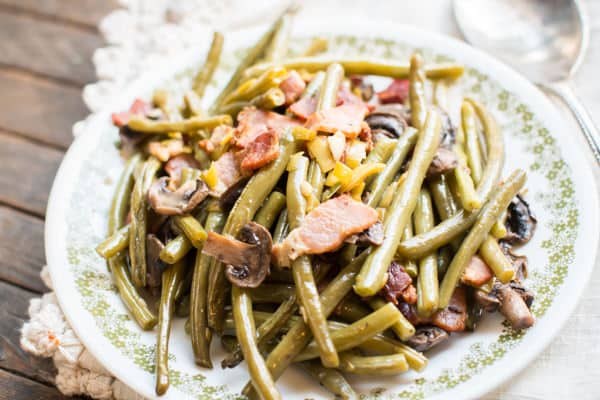 green beans, bacon and mushrooms on a plate.