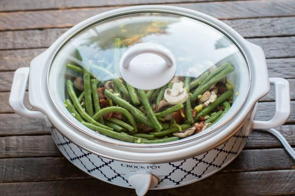 green beans in a slow cooker with a lid on.