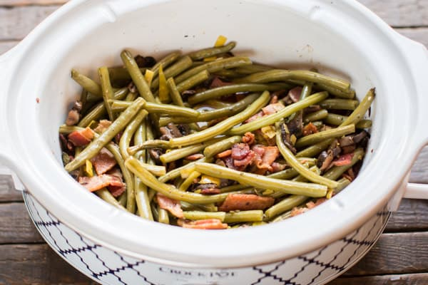 cooked holiday green beans in a slow cooker.