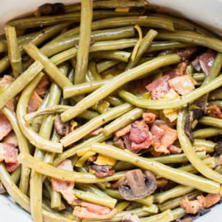 cooked green beans with bacon in a slow cooker.