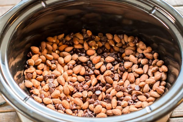 almonds and chocolate chips mixed together in a slow cooker.