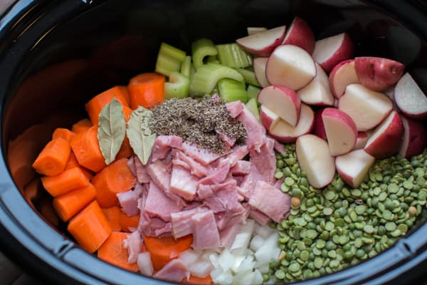 split peas, ham, red potatoes, carrots, onion, and seasoning in a slow cooker.