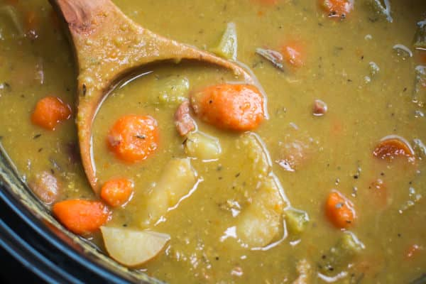 ultra close up shot of split peas stew with large chunks of carrots and potatoes.