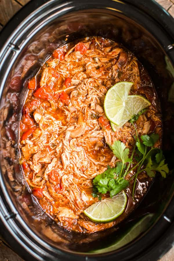 shredded salsa chicken in a slow cooker.