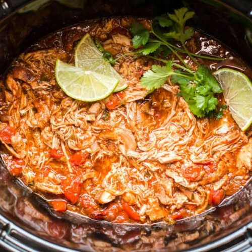 homemade salsa chicken in slow cooker with limes