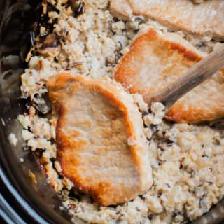 wild rice mix and pork chops in a slow cooker.