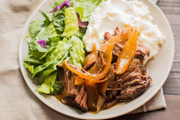 Shredded amish pot roast with mashed potatoes and salad.
