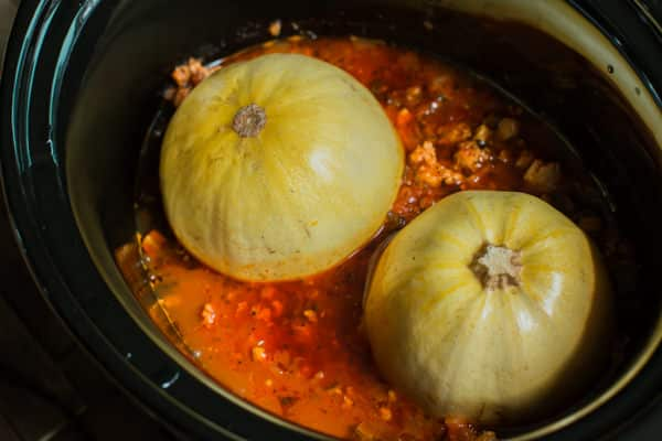 turkey meat sauce with halved spaghetti squash in a slow cooker.