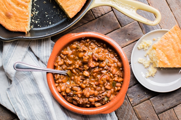 bowl of land your man baked beans with cornbread.