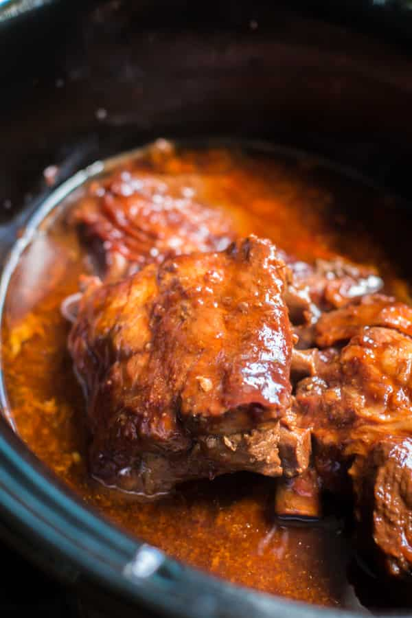 cooked ribs quarters in a slow cooker.