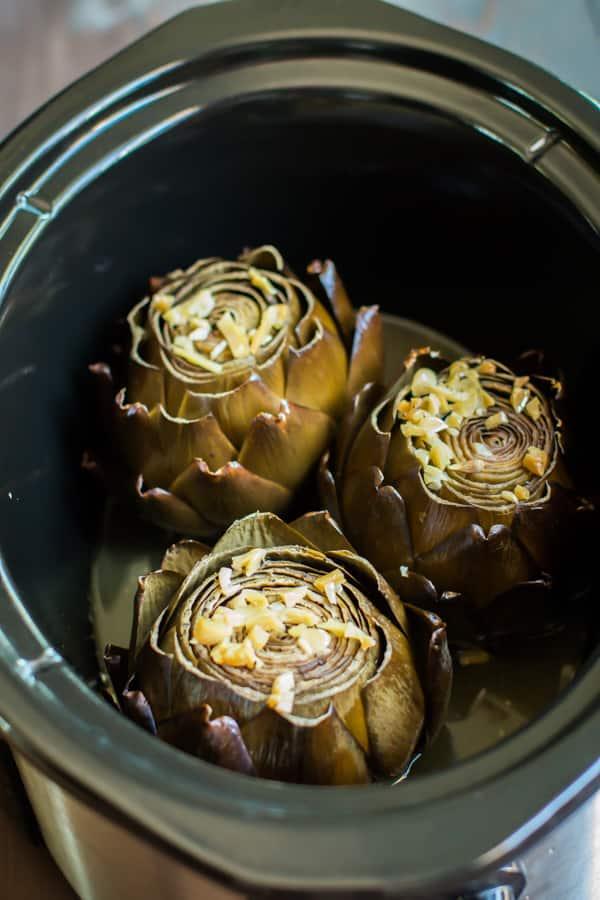 Slow Cooker Garlic Lemon Butter Artichokes