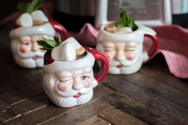 santa mugs with mint hot chocolate in them.