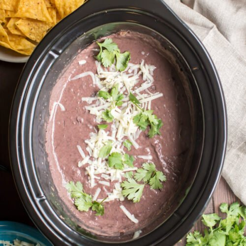 refried black beans in a slow cooker