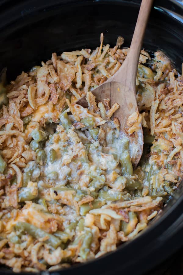 close up image of cheesy green bean casserole with French fried onions.