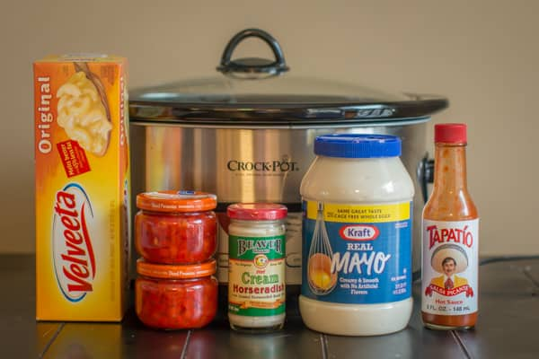 mayo, velveeta, pimentos, horseradish and hot sauce in front of slow cooker.