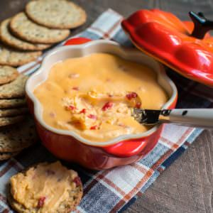 horseradish velveeta dip in a pumpkin shaped bowl
