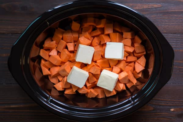 cubed sweet potatoes with butter pats on top.