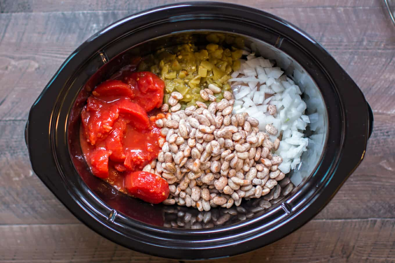 pinto beans, tomatoes, green chiles and onion in a slow cooker