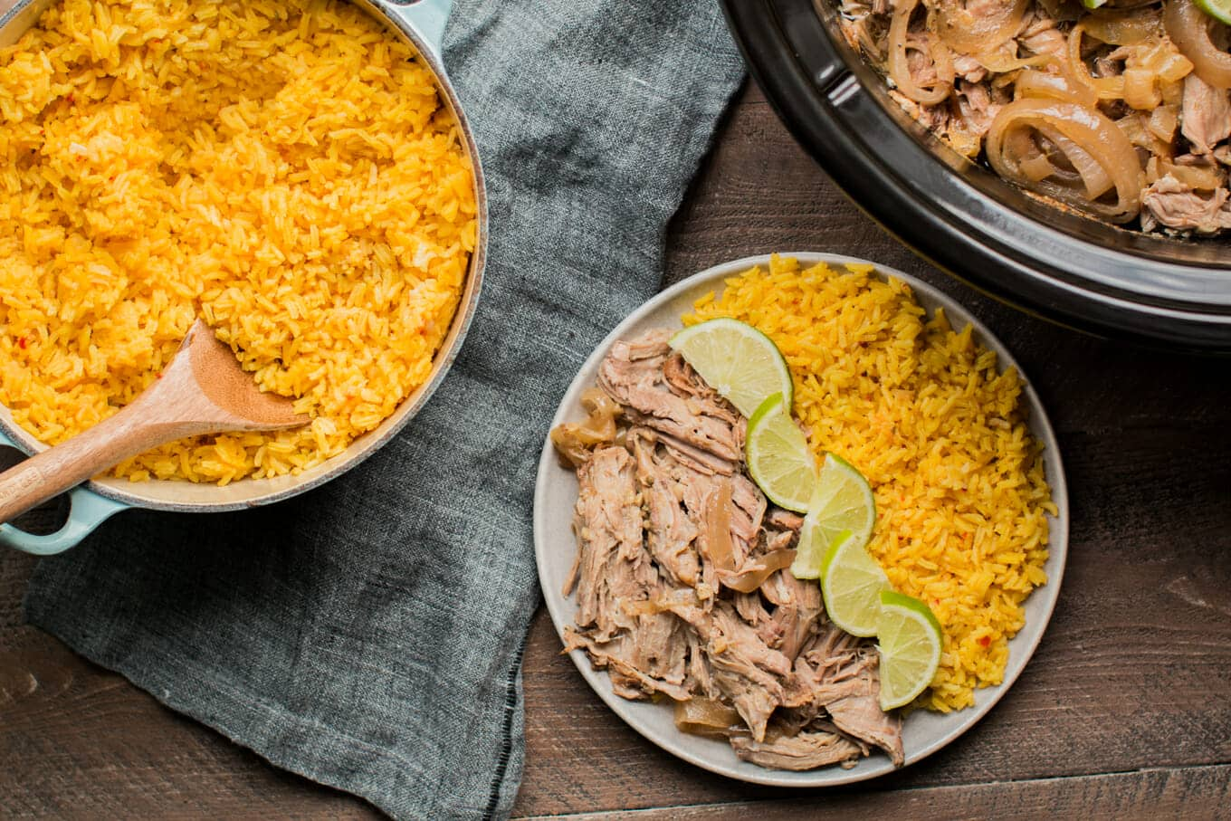plate of cuban beef, limes and yellow rice.