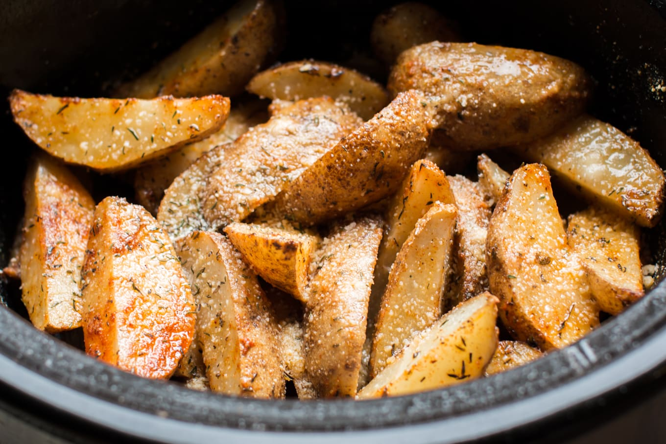 Close up of potato wedges in slow cooker.