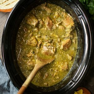 pork chunks cooked in slow cooker in a green chile sauce.