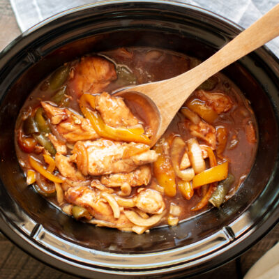 chicken tenders with bell peppers and onion in barbecue sauce.