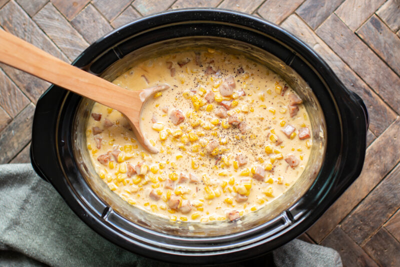 corn in a cheesy sauce with black pepper on top.