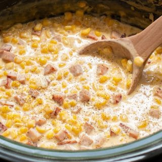 close up of ham and cheese corn with wooden spoon in it.