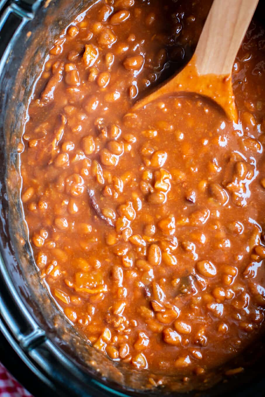 close up photo of root beer baked beans in slow cooker