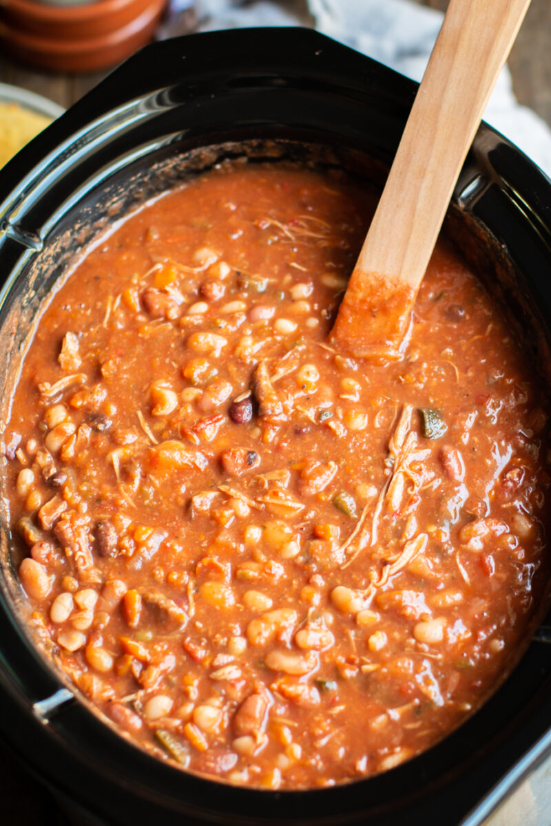 close up of cajun 15 bean soup in a slow cooker.