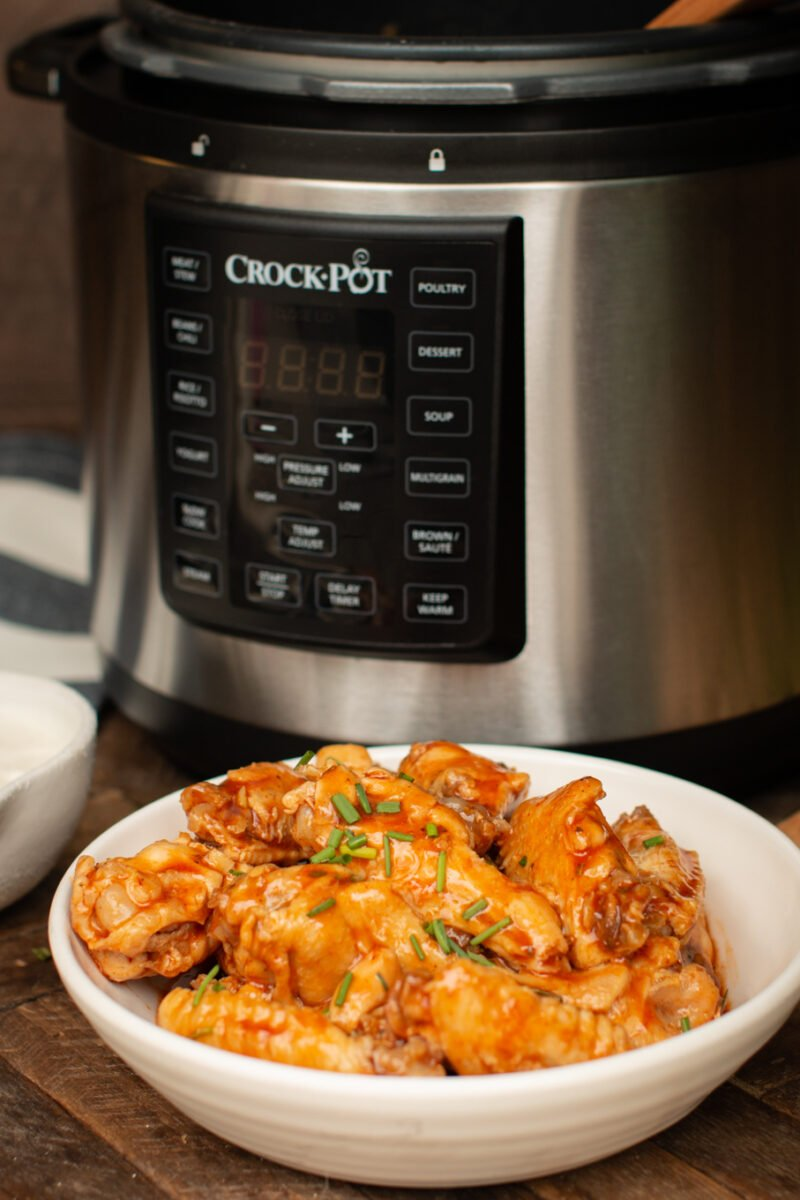 buffalo wings in front of a slow cooker