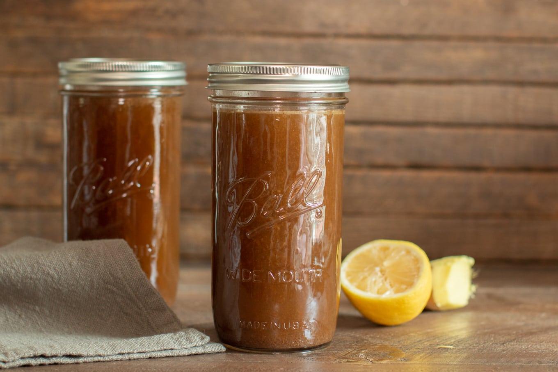 2 ball mason jars with beef bone broth in them.
