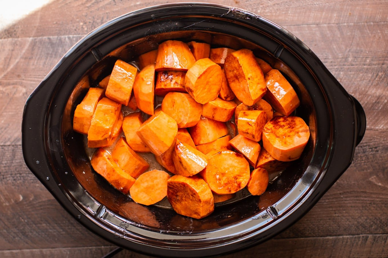 raw yams ready to cook in the slow cooker.