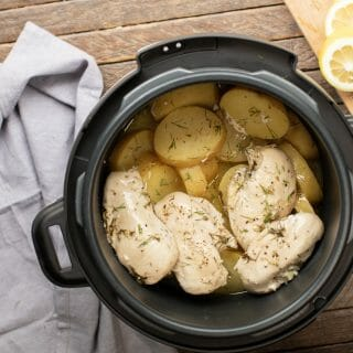 lemon chicken, gold potatoes and dill in a pressure cooker.