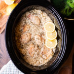 rice and chicken in slow cooker with lemon slices