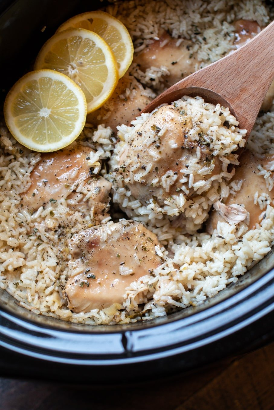 close up of lemon chicken and rice in slow cooker.