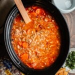 soup with buffalo sauce, carrots and variety of beans in a slow cooker.