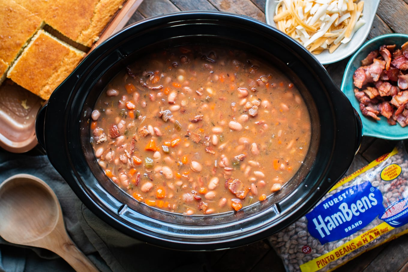 pinto beans and bacon cooked in slow cooker with cheese and cornbread.