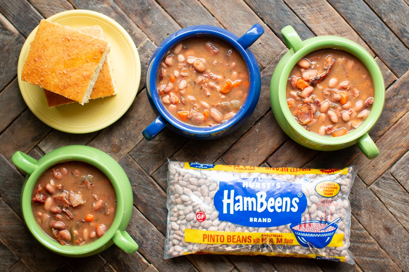 3 bowls of pinto beans with cornbread and bag of HamBeens pinto beans with ham flavor.