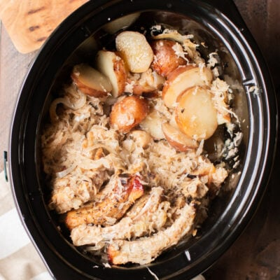 ribs, sliced potatoes and sauerkraut in a slow cooker