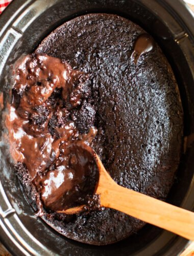 chocolate lava cake in a slow cooker with a spoon in it.