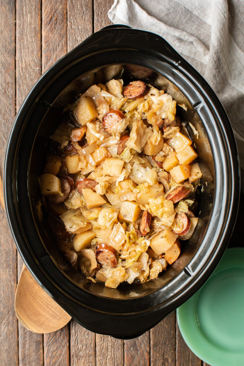 cooked potatoes, cabbage, and sliced kielbasa in a slow cooker.