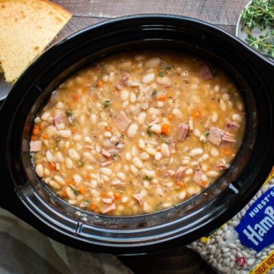 white beans and ham soup in slow cooker with cornbread on the side.
