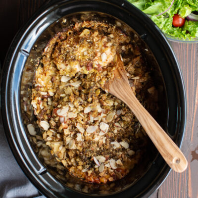 chicken with stuffing and almonds on top.