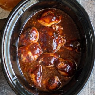 chicken thighs in root beer barbecue sauce in slow cooker.